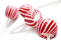 Colorful red lollipops on white background