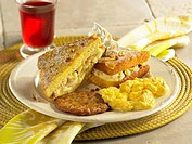 Banana French Toast.Banana french toast served with sausage and scrambled eggs