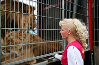 Female lion-tamer during show of Circus Renz in Maastricht