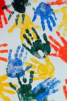 Colorful hand imprints in various shapes and patterns