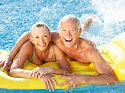 Senior couple having fun in pool