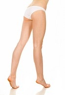 Slender and long beautiful female legs, isolated on white background