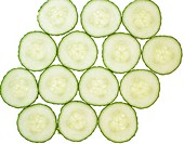 Pattern of fresh cucumber slices , isolated on a white background.