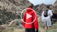 Group of friends hiking on desert trail in rainy weather, Red Rock Canyon, Nevada, USA
