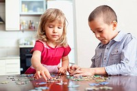 Children, playing puzzles at home