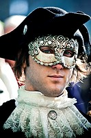 masked man with fancy dress in Carnival of Venice Venice, Italy