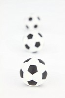 Three footballs on white background