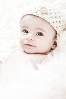 Cute 3_Months Baby wearing a white knit hat