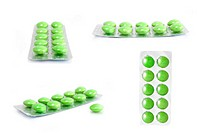 packs of green tablets isolated on white