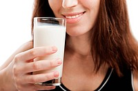 Smiling woman drinking healthy lifestyle milk food