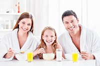 A happy family with a child in the morning in the kitchen