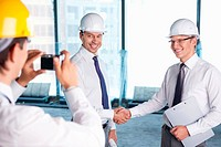 A man photographed handshake business partners in construction