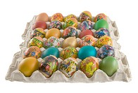 Fresh rural painted eggs are decorated by various techniques before Easter packed into cardboard container.