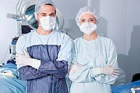Portrait of young confident surgeons in operation theatre