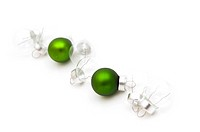 green and silver christmas balls shaped diagonally on white background