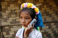 A Longneck girl listens to a cell phone Approximately 300 Burmese refugees in Thailand are members of the indigenous group known as the Longnecks The ...