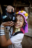 A Longneck girl plays with a camera Approximately 300 Burmese refugees in Thailand are members of the indigenous group known as the Longnecks The larg...