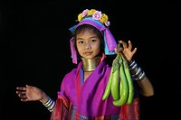 A young Longneck girl displays fresh fruit Approximately 300 Burmese refugees in Thailand are members of the indigenous group known as the Longnecks T...