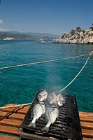 grilled fish on the deck, ship cruise in Kekova bay, Turkey, Eurasia
