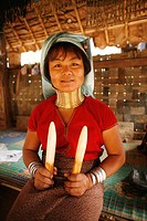 A Longneck woman holds ivory elephant tusks Approximately 300 Burmese refugees in Thailand are members of the indigenous group known as the Longnecks ...