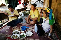 A Longneck family eats a meal together on their porch Approximately 300 Burmese refugees in Thailand are members of the indigenous group known as the ...