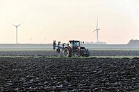 Farmer plowing with a tractor, near Brokdorf, Schleswig-Holstein, Germany, Europe