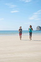 Two women jogging along the beach, Camaret_sur_Mer, Finistere, Brittany, France, Europe