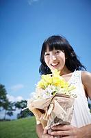 A woman happy with yellow flower