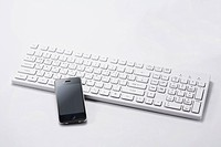 A smart phone on the keyboard