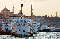 Ferries pier and Suleimaniye mosque in background  Istanbul  Turkey.