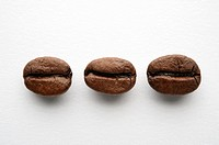Three Coffee Beans on White Background