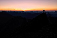 Mountain panorama with climber at sunset, Mt. Feuerspitze, Steeg, Lech, Ausserfern, Tyrol, Austria, Europe