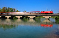 Austrian Federal Railway OEBB on the Saalach river bridge between Austria and Germany