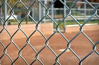 Background of a Baseball Dugout through a chain link fence