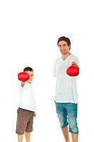 Father and son showing hands in boxing gloves isolated on white background