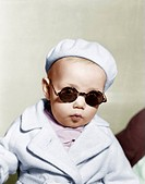 Portrait of baby wearing beret and sunglasses All persons depicted are not longer living and no estate exists. Supplier warranties that there will be ...