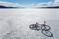 Bicycle on ice surface of huge frozen Lake Laberge, Yukon T, Canada, in April.