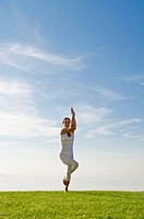 Young woman practising Hatha yoga outdoors, showing the pose Garudasana, eagle pose, Nove Mesto, Okres Teplice, Czech Republic, Europe