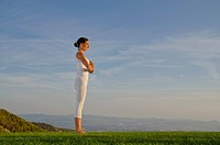 Young woman practising Hatha yoga outdoors, showing the pose surya namaskar 2, sun salutation 2, Nove Mesto, Okres Teplice, Czech Republik, Europe