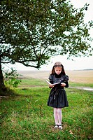 An image of little girl wit book