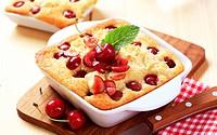 Freshly baked cherry sponge cake in porcelain casserole dish
