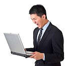 Angry business man holding laptop on white background.