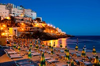 Evening view of the beach and the rock on which the beautiful Italian city of Sperlonga