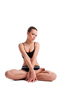 Beauty young woman sit in lotos asana ready for fitness on white