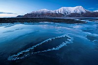 Frozen river Longyearelva on Adventfjorden, Longyearbyen, Svalbard, Spitsbergen, Norway, Scandinavia, Europe