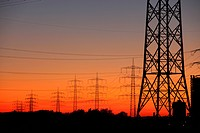 High voltage transmission lines, power lines, sunset, between Essen, Bottrop and Oberhausen, North Rhine-Westphalia, Germany, Europe