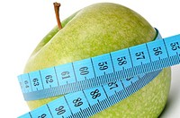 Diet concept _ apple and measuring tape isolated on white