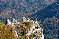 Climbers at the summit cross of Stuhlfels mountain, Upper Danube Nature Park, Sigmaringen district, Baden-Wuerttemberg, Germany, Europe