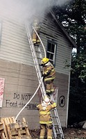 Firefighters fight a fire in an old abandoned graffiti marked house in Maryland