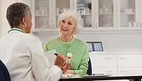 Doctor explaining prescription to patient